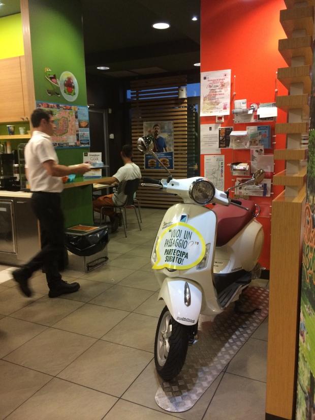 Vespa inside McDonald's.