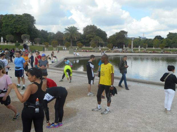 Stretching at the Jardin du Luxembourg after we finished.
