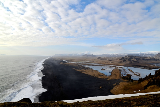 Black beaches mixed with volcanoes and glaciers in Iceland.